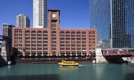 Yellow boat on CHicago River stock images
