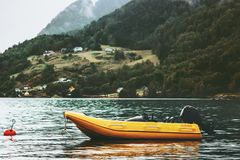 Yellow boat fjord and foggy Mountains Landscape Royalty Free Stock Images