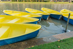 Yellow boat in the garden park. On summer Stock Photo