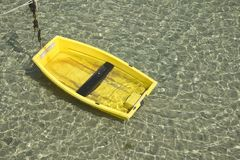Yellow boat, green sea Stock Photography
