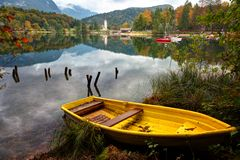Yellow boat on Lake Bohinj Royalty Free Stock Image