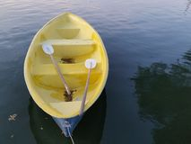 Yellow Boat on the lake Royalty Free Stock Images
