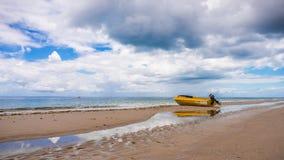 Yellow Boat Low Tide Beach Moreton Island Australia stock photo