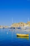 Yellow Boat at a Marina, Malta Stock Image