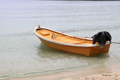 The yellow boat is parked on the beach. The yellow boat is floating on the sea stock image