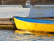 Yellow boat at pier Royalty Free Stock Photos