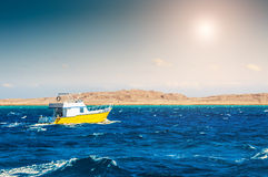 Yellow boat in the red sea. Beautiful summer seascape royalty free stock image