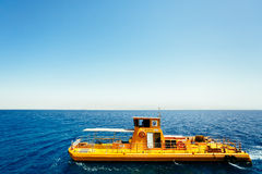 Yellow boat in Red sea Stock Photo