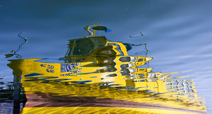 Yellow boat reflection Stock Photo