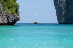 Yellow boat between the rocks Stock Image