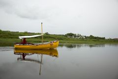 Yellow boat with sailor Royalty Free Stock Photography