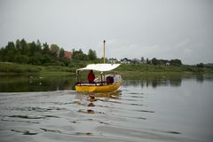 Yellow boat with sailor Stock Image