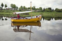 Yellow boat with sailor Royalty Free Stock Photo