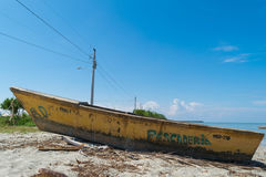 Yellow boat in the sand. Photo taken in Dominican Republic Stock Images