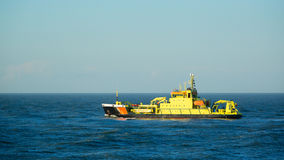 Yellow Boat at Sea on a Clear Day Royalty Free Stock Photo