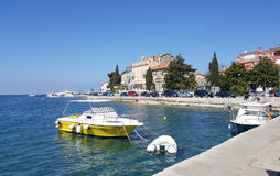 Yellow boat on the sea with Rovinj old town background Royalty Free Stock Photos
