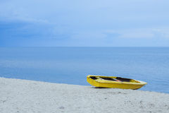 Yellow boat on the sea shore. Royalty Free Stock Image