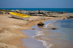 Yellow boat at the shore Royalty Free Stock Photography