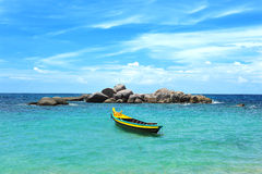 Yellow boat in the turquoise sea Royalty Free Stock Photography