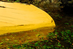 Yellow boat in water Royalty Free Stock Photos