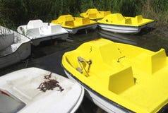 Yellow boats. Yellow and white boats on lake Stock Photo