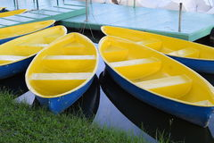 Yellow boats at pier on sunshine day Royalty Free Stock Image