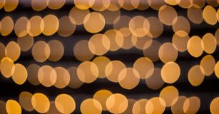 Free Yellow Bokeh Balls Background. Golden Holiday Glowing Backdrop. Defocused Background With Blinking Stars. Royalty Free Stock Photography - 169319357