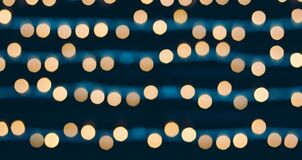 Free Yellow Bokeh Balls Background. Golden Holiday Glowing Backdrop. Defocused Background With Blinking Stars. Toned Image Royalty Free Stock Photography - 169319237