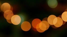 Yellow bokeh effect. Bokeh lights against a black background stock video