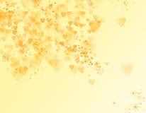 Yellow bokeh with hearts Stock Photo