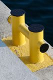 Yellow bollard pier - device for yacht mooring in marina Royalty Free Stock Photos