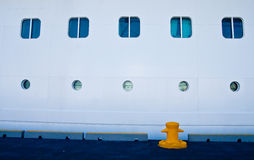 Yellow Bollard by Ships Portholes Stock Images