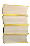 Yellow books stack isolated Stock Images