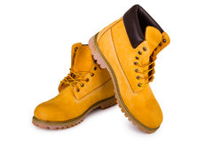 Yellow boots. Yellow men's boots  on white background Stock Photos