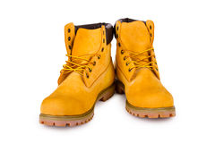 Yellow boots. Yellow men's boots on white background stock photo