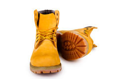 Yellow boots. Yellow men's boots isolated on white background Royalty Free Stock Image
