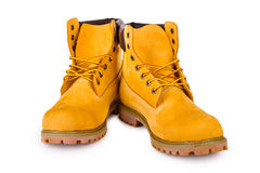 Yellow boots. Yellow men's boots isolated on white background Royalty Free Stock Photography