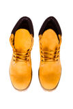 Yellow boots. Yellow men's boots isolated on white background Royalty Free Stock Photo