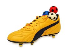Yellow boots and footballs. On the white Royalty Free Stock Images