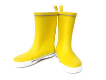 Yellow boots. Yellow rubber boots isolated on white background Stock Photos