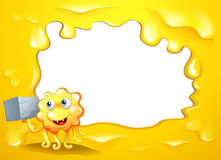 A yellow border design with a smiling monster Stock Photos