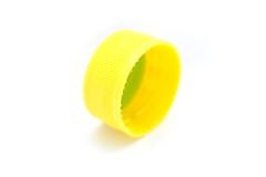 Yellow Bottle Cap. A photo of a yellow bottle cap over a white background Royalty Free Stock Images