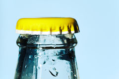 Yellow bottle cap. Yellow Water bottle cap isolated on blue Stock Photography