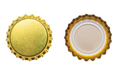 Yellow bottle caps isolated on white Stock Image
