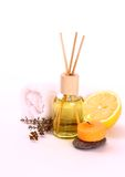 Yellow bottle with essential oil, candle and bath towel Stock Photo