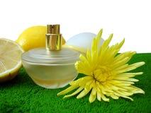 Yellow bottle of perfume Royalty Free Stock Photos