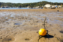 Yellow Bouy. At low tide Stock Photography