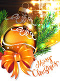 Yellow bow and Christmas bauble Stock Image