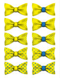 Yellow bow tie with blue dots set realistic vector illustration Stock Photos