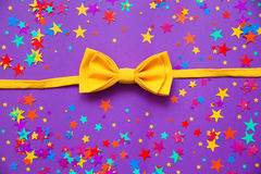 Yellow bow tie on a purple background Stock Photos